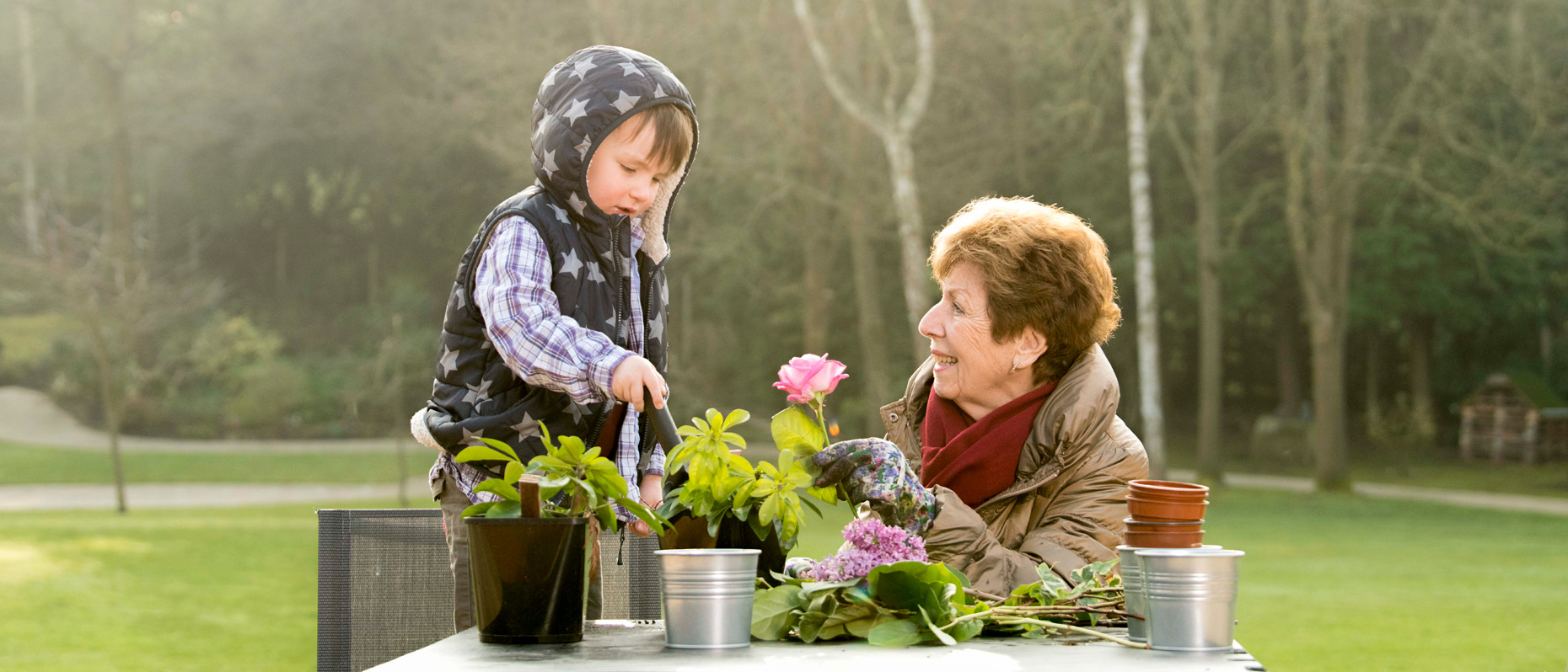 grandma and child playing together with flowers
